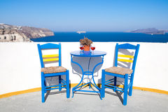 Blue chairs and table on a mediterranean balcony with nice view Royalty Free Stock Image