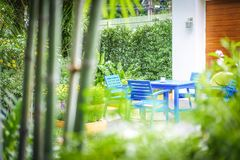 Blue chairs and table set in the garden royalty free stock photo