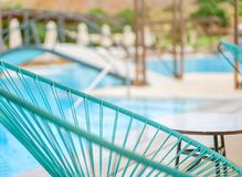 Blue chaise longue close up on a blurred pool background. Greece royalty free stock image