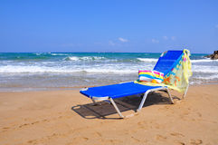 Blue chair on the beach. Blue chaise lounge on the beach Stock Photography