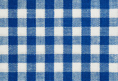 Blue check. Background of blue and white check tablecloth fabric Stock Photos