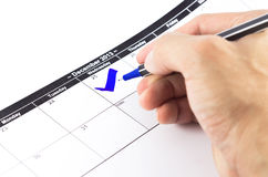 Blue check. Mark on the calendar at 25 December 2013 Royalty Free Stock Photography