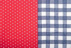 Blue checked fabric. On red polka dot fabric Stock Photo
