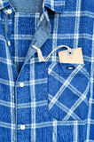 Blue checked shirt with price tag Stock Photos