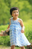 Blue checked skirt little girl holding teddy bear Royalty Free Stock Photo