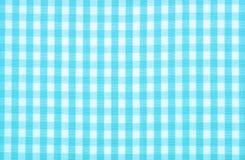 Blue checkered fabric. A blue checkered fabric background Royalty Free Stock Image