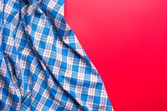 Blue Checkered Fabric on red Background. Blue Checkered Fabric on red Background Royalty Free Stock Image