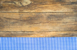 Tablecloth blue checkered on rustic wooden table. Blue checkered fabric on rustic brown wooden table Stock Images