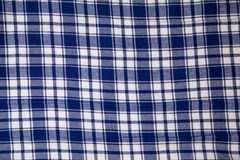 Blue checkered fabric texture, background with copy space. For your text Stock Image