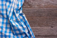 Blue Checkered Fabric on wood  Background.  Royalty Free Stock Photo