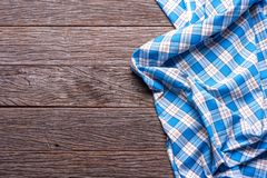 Blue Checkered Fabric on wood  Background.  Royalty Free Stock Image