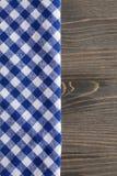 Blue checkered napkin on gray wooden table Royalty Free Stock Photos