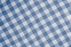 Blue checkered tablecloth background Royalty Free Stock Images