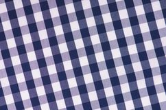 The blue checkered tablecloth Stock Photography