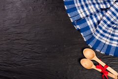 Blue checkered tablecloth on the black stone table with copy space for your text. Top view Stock Photo