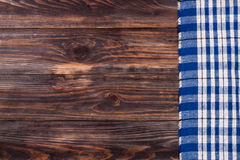 Blue checkered tablecloth on the black wooden table with copy space for your text. Top view Royalty Free Stock Image