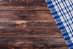 Blue checkered tablecloth on the black wooden table with copy space for your text. Top view Stock Image