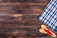 Blue checkered tablecloth on the black wooden table with copy space for your text. Top view Royalty Free Stock Photos