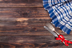 Blue checkered tablecloth on the black wooden table with copy space for your text. Top view.  Stock Photo