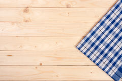 Blue checkered tablecloth on a light wooden table with copy space for your text. Top view Stock Photos