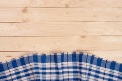 Blue checkered tablecloth on a light wooden table with copy space for your text. Top view Royalty Free Stock Photos