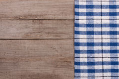 Blue checkered tablecloth on an old wooden table with copy space for your text. Top view Stock Photo