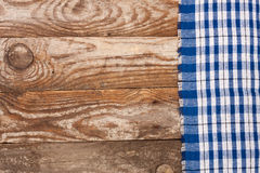 Blue checkered tablecloth on the old wooden table with copy space for your text. Top view Royalty Free Stock Photo