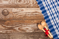 Blue checkered tablecloth on the old wooden table with copy space for your text. Top view.  Stock Images