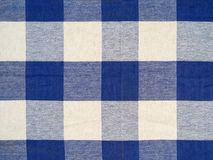 Blue checkered tablecloth. Photo of a blue checkered tablecloth Stock Image
