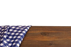 Blue Checkered Tablecloth On The Rough Rustic Wooden Table Isola. Blue Checkered Tablecloth On The Rough Rustic Brown Pine Picnic Wooden Table Isolated On White Royalty Free Stock Photos