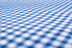 Blue checkered tablecloth Stock Images