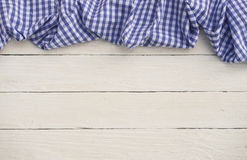 Blue checkered tablecloth on white wood Stock Images