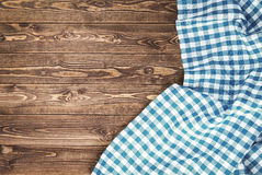 Blue checkered tablecloth on wooden table Royalty Free Stock Photo
