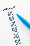 Blue checklist. Checklist with checkboxes ticked using blue pen Stock Photo