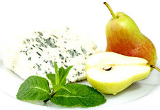 Blue Cheese. Roquefort cheese on a plate with pears Royalty Free Stock Photo