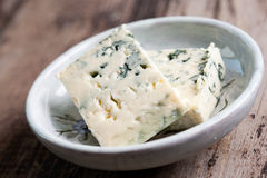 Blue cheese. Pieces in a plate Royalty Free Stock Photo