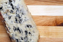 Blue cheese. On a wooden plate with copyspace royalty free stock photo