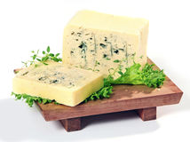 Blue cheese. And lettuce on wooden cutting board stock photos