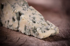 Blue cheese. On wooden background stock photos