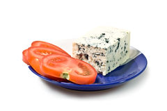 Blue cheese. And tomato slices on the plate, isolated on white background Stock Photography