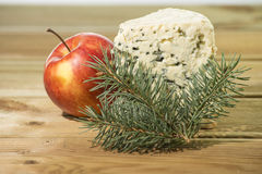 Blue cheese with apple. Blue cheese in christmas decoration Royalty Free Stock Photography
