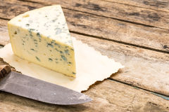 Blue cheese background with copyspace. Royalty Free Stock Photos