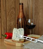 Blue cheese, a bottle and a glass of wine. Still life with wine and cheese Royalty Free Stock Images