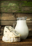 Blue cheese and brie with a jug of milk Stock Photography