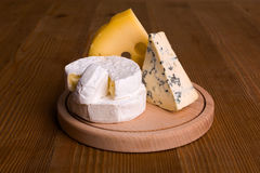 Blue cheese, camembert and emmental cheese Stock Photography