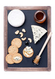 Blue cheese and camembert with honey. Cheeseboard Stock Image