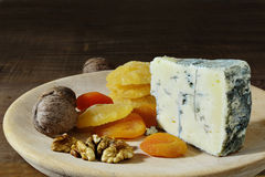 Blue cheese with candied fruits and walnuts Royalty Free Stock Photo