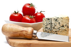 Blue cheese and cherry tomatoes Royalty Free Stock Images