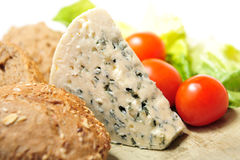 Blue cheese with cherry tomatoes Royalty Free Stock Images
