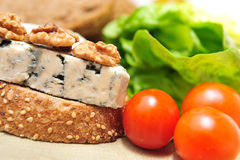 Blue cheese with cherry tomatoes Stock Photo